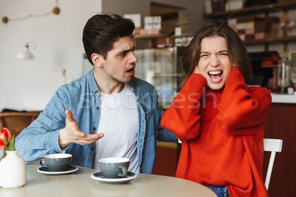 Deluso Coppia donna uomo 20s urlando Foto d'archivio © deandrobot