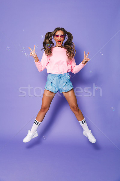 Full length portrait of excited joyous girl with two ponytails i Stock photo © deandrobot
