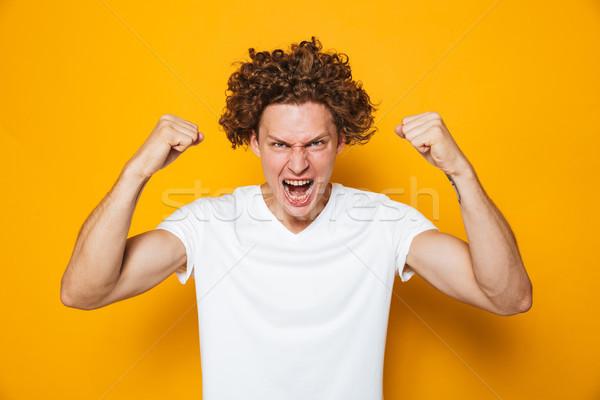 Foto forte uomo 20s casuale Foto d'archivio © deandrobot