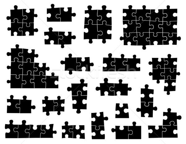 Szett különböző kirakó darabok izolált fehér papír Stock fotó © DeCe