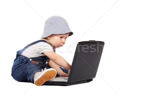 мало мальчика ноутбука сидят изолированный белый Сток-фото © DedMorozz
