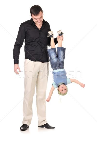 Foto stock: Homem · pequeno · menino · de · cabeça · para · baixo · branco · diversão