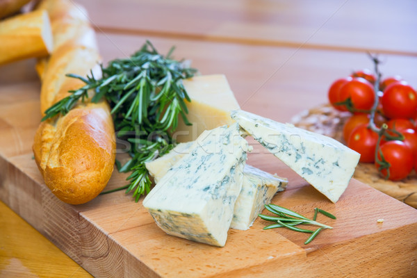 Cheese and bread on the wooden board Stock photo © DedMorozz