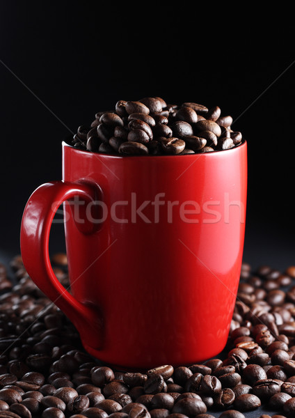 Cup with coffee beans Stock photo © DedMorozz