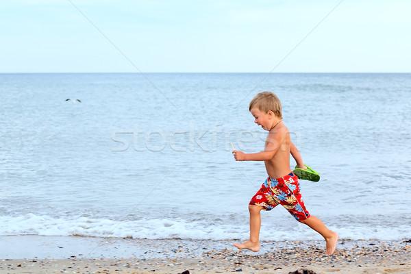 мало мальчика работает берега морем здоровья Сток-фото © DedMorozz