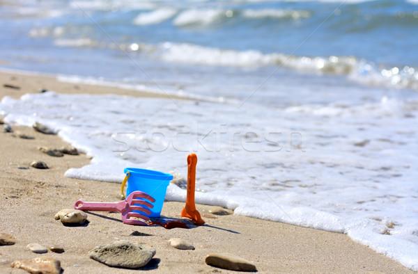 пластиковых ковша пляж морем лет песок Сток-фото © DedMorozz