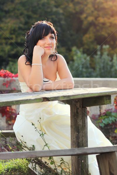 Lány esküvői ruha ül pad takaros asztal Stock fotó © DedMorozz