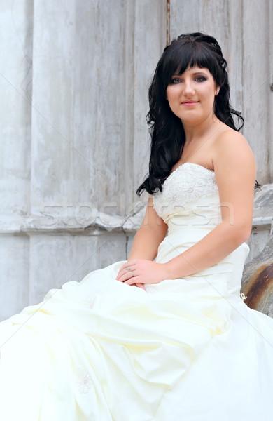 Girl in the wedding dress sitting Stock photo © DedMorozz