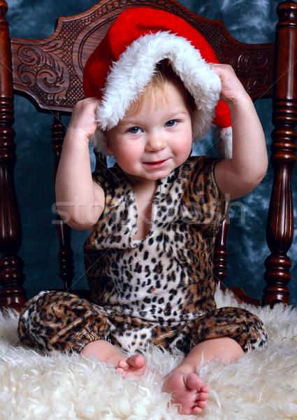 Little boy dresses up santa's hat Stock photo © DedMorozz