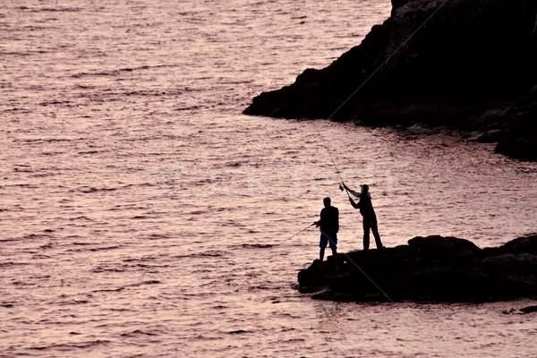 двое мужчин рыбалки пляж воды закат пейзаж Сток-фото © DedMorozz