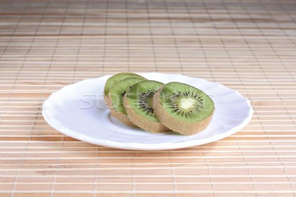 Stockfoto: Kiwi · plaat · stukken · witte · schotel · groene