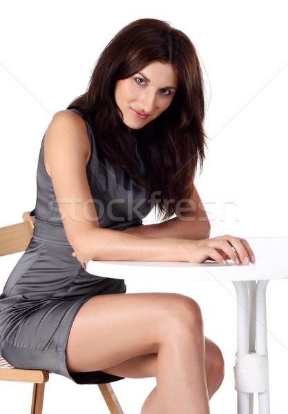 девушки сидят Председатель таблице женщину лице Сток-фото © DedMorozz