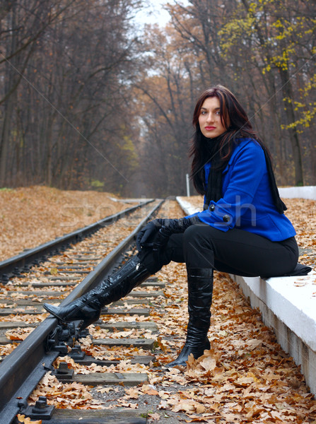 Young woman near the rails Stock photo © DedMorozz