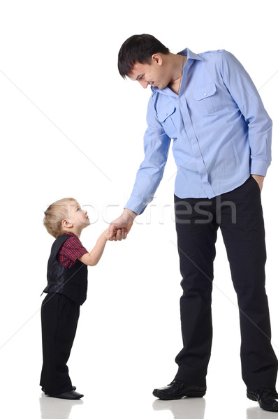 Stock photo: Handshake of a man and boy