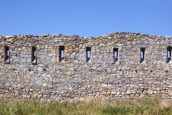 Ancient broken wall with little windows Stock photo © DedMorozz