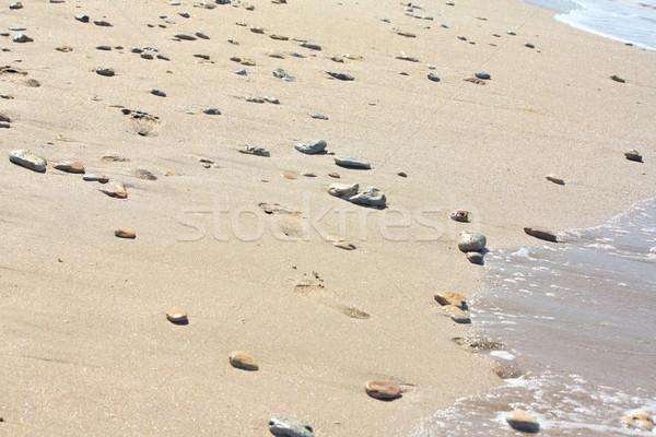 Footprints at the beach among the stones Stock photo © DedMorozz