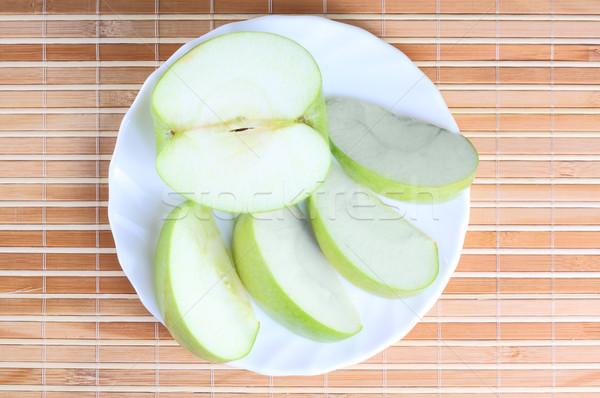 Stock photo: Apple pieces on the plate