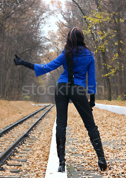 Young woman hitchhiking Stock photo © DedMorozz