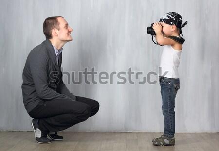 Little boy takes a photo of a man Stock photo © DedMorozz