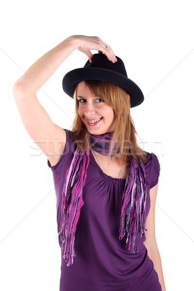 Girl with brackets in a hat Stock photo © DedMorozz
