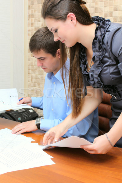 Girl and man working in the office Stock photo © DedMorozz