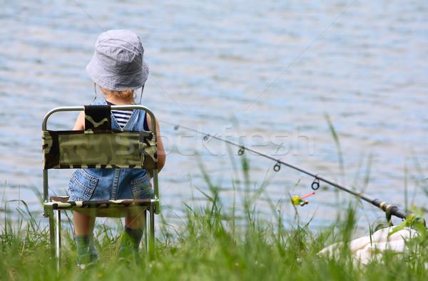 мало мальчика удочка стержень сидят озеро Сток-фото © DedMorozz