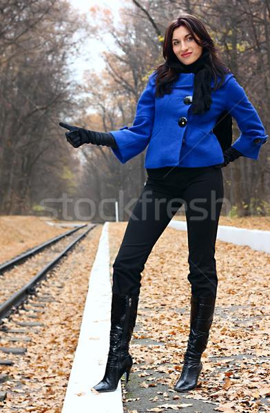 Young woman hitchhiking Stock photo © DedMorozz