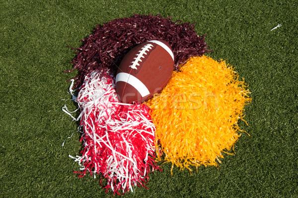 American Football and Pom Poms on Field Stock photo © dehooks