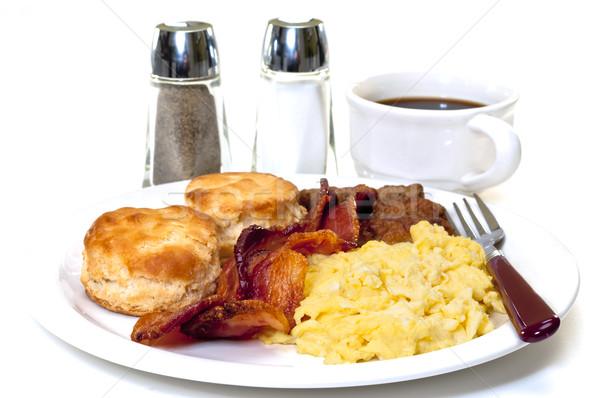 Groot land ontbijt geïsoleerd roereieren spek Stockfoto © dehooks