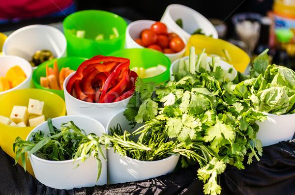 Saláta hozzávalók saláta paradicsomok uborkák sajt Stock fotó © dehooks