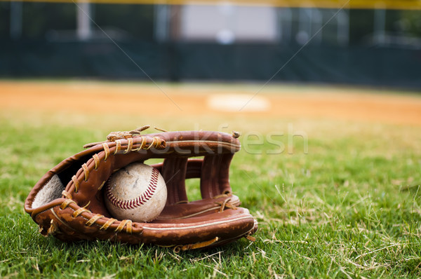 Old Baseball and Glove on Field Stock photo © dehooks