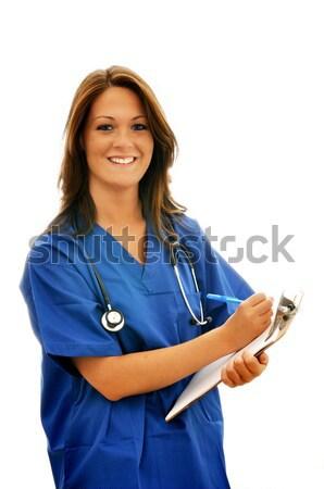 Mosolyog női nővér sztetoszkóp vágólap izolált Stock fotó © dehooks