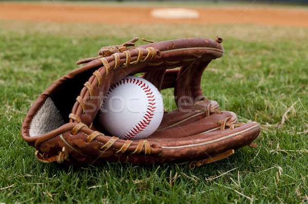 Baseball in Old Glove on Field Stock photo © dehooks