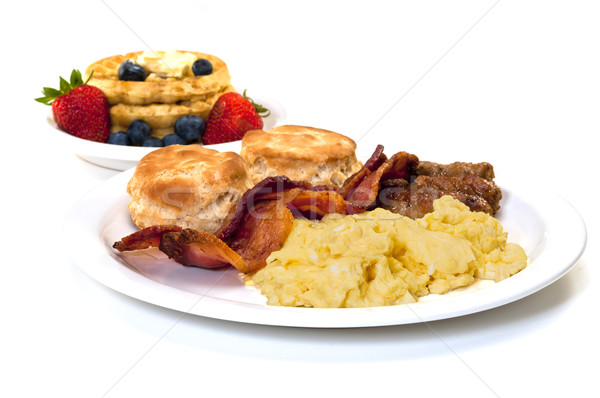 Breakfast with Eggs, Bacon , Sausage, Biscuits  and Waffles Stock photo © dehooks