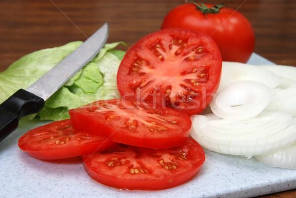 Paradicsom saláta hagymák kés vágódeszka sekély Stock fotó © dehooks