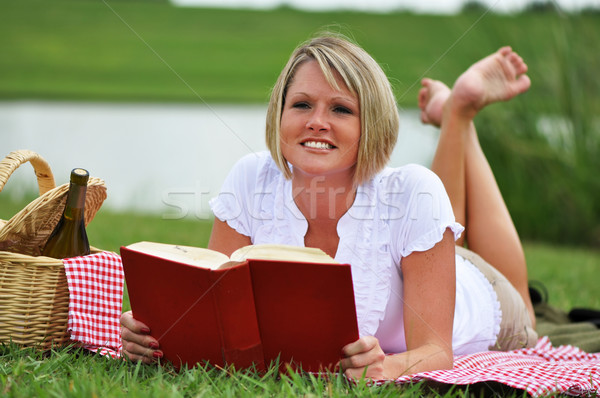 Woman on Picnic with Wine and Book Stock photo © dehooks