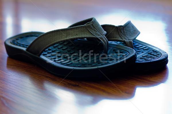 Papucs keményfa padló pár közelkép nyár cipő Stock fotó © dehooks