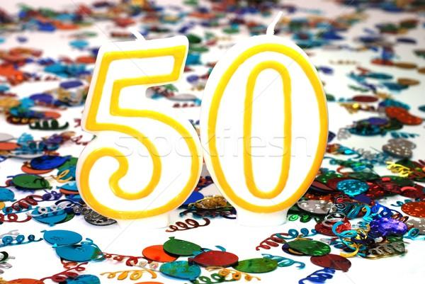 ünneplés gyertya szám 50 konfetti buli Stock fotó © dehooks