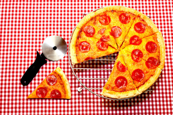 Whole Pepperoni Pizza and Cutter Stock photo © dehooks