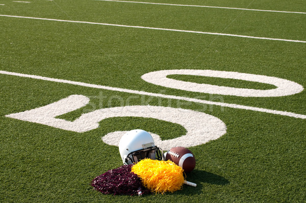 American Football Equipment and Pom Poms on Field Stock photo © dehooks