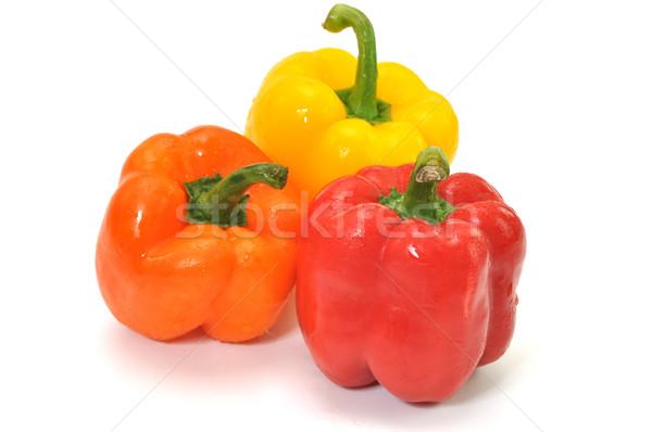 Bel paprika drie kleurrijk geïsoleerd witte Stockfoto © dehooks