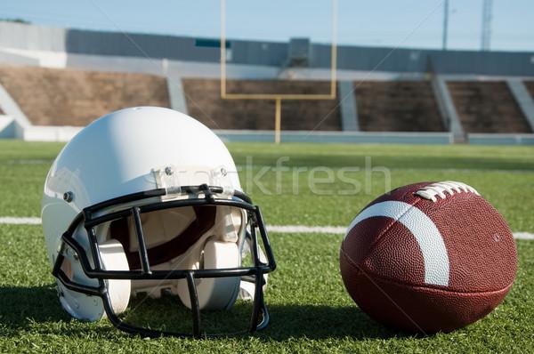 American Football and Helmet on Field Stock photo © dehooks