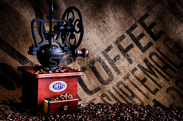 Coffee Beans and Grinder with Bag Closeup Stock photo © dehooks