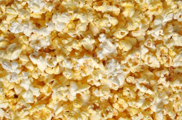 Pattogatott kukorica közelkép mozi színház citromsárga előadás Stock fotó © dehooks