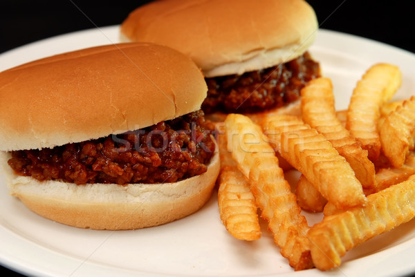 Frietjes twee gesneden geïsoleerd zwarte Stockfoto © dehooks