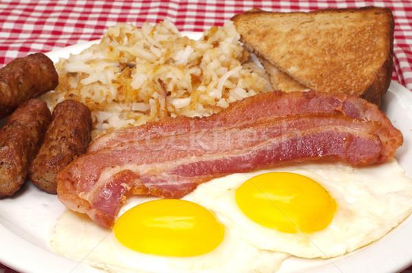 Reggeli tányér tojások napos oldal felfelé Stock fotó © dehooks