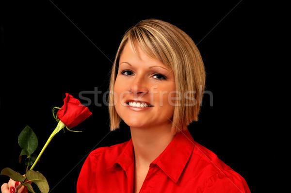 Fiatal szőke nő piros rózsa fekete virág Stock fotó © dehooks