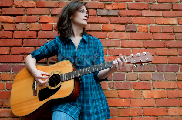 Young Brunette Female  Playing Guitar Stock photo © dehooks