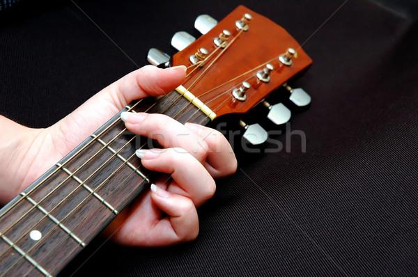 Lány játszik gitár közelkép nő kéz Stock fotó © dehooks