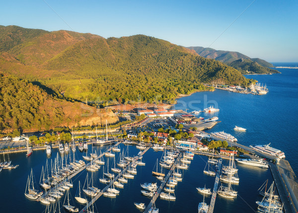 Aerial view of boats and beautiful mountains at sunset Stock photo © denbelitsky